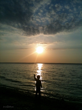 Child Rock Toss Silhouette Lake Michigan Sun
